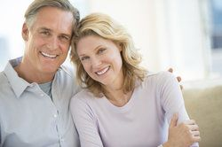older couple smiling at camera