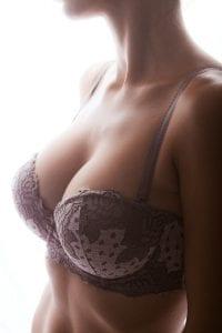Woman in purple bra looking away