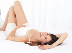 woman laying on floor smiling back at camera