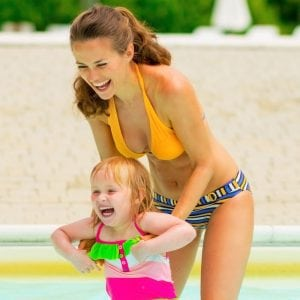 Mom and Daughter playing in a pool
