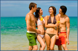group of people laughing at beach