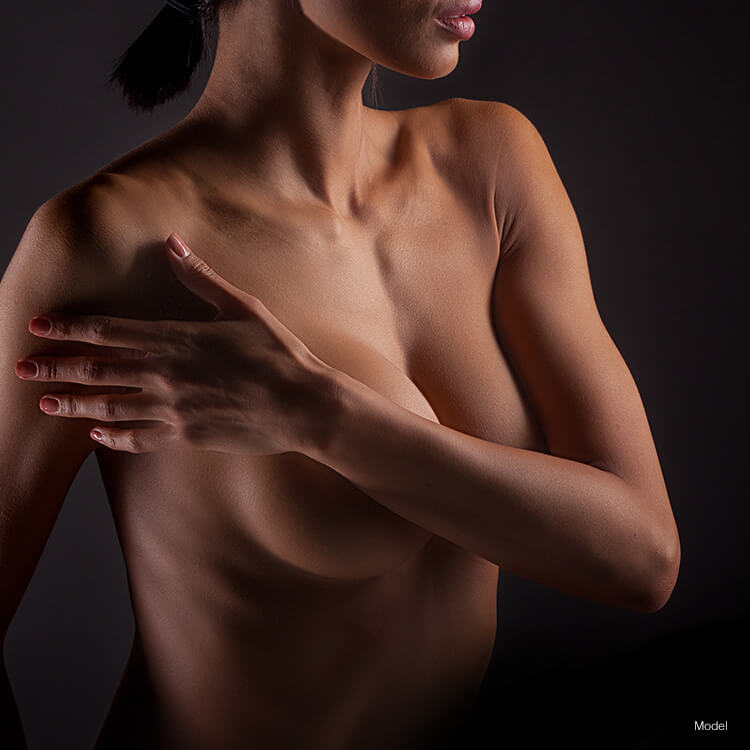 Woman with arms covering her breast