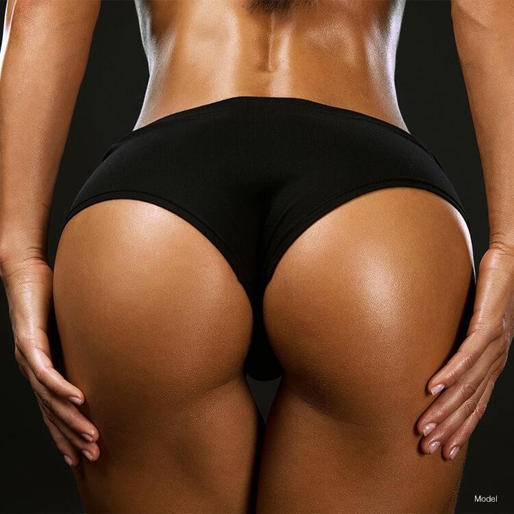 Woman holding butt