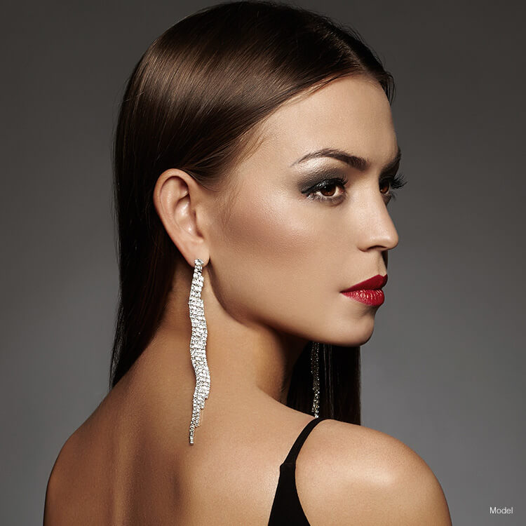 Woman with nice earrings looking over shoulder