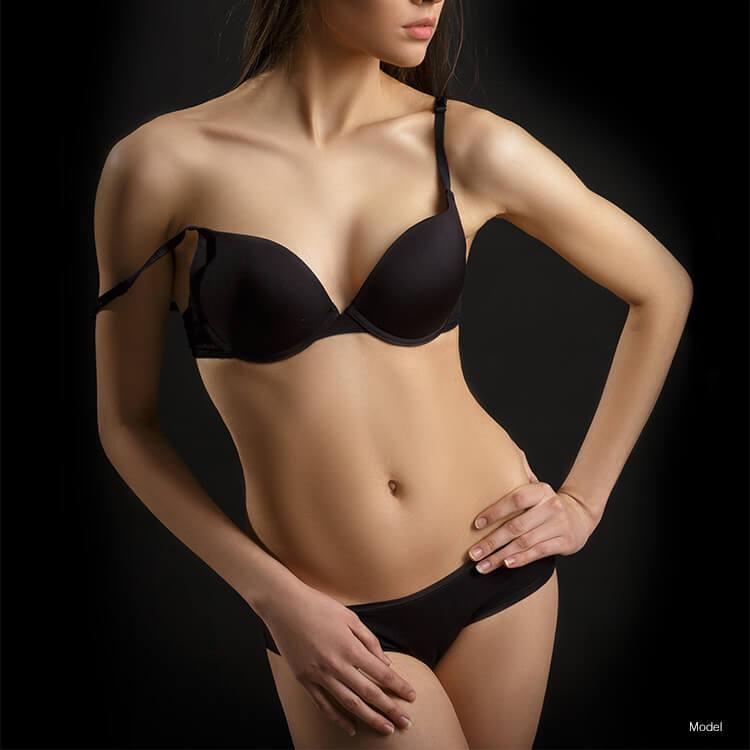 Woman with nice body in black bikini