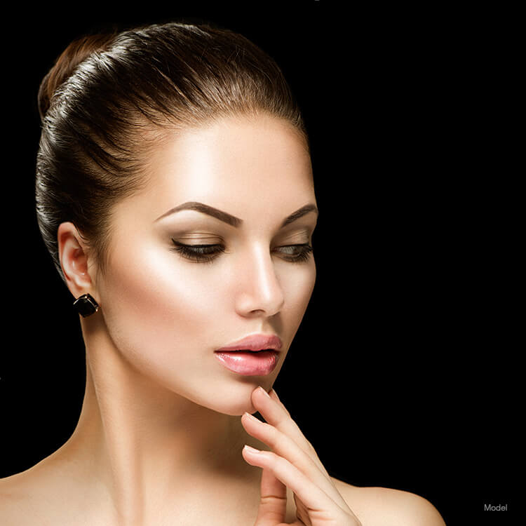 Model's face after a belfilla injectable filler