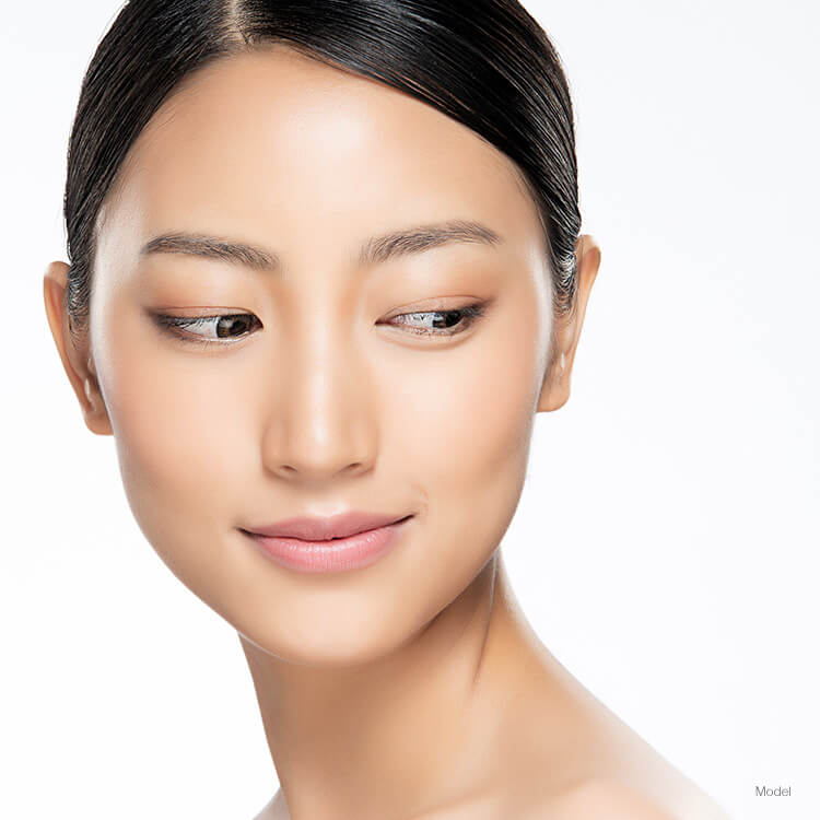 Model's face with a dermal implant