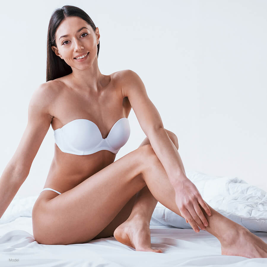 model wearing white undergarments posing after truSculpt®